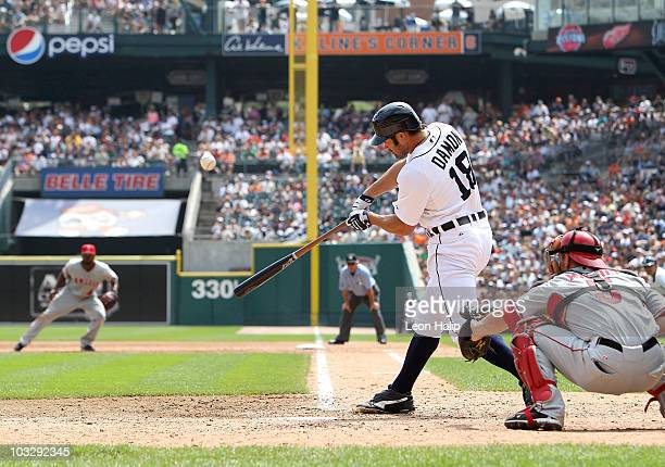 Johnny Damon of the Detroit Tigers singles to right field scoring Don Kelly and Alex Avila in the eighth inning against the Los Angeles Angels of...