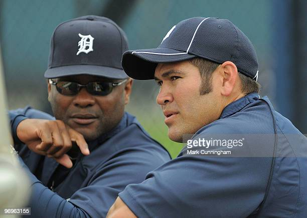 Johnny Damon of the Detroit Tigers talks with hitting coach Lloyd McClendon during Damon's first workout with the Tigers on February 22 2010 in...