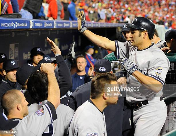 Johnny Damon of the New York Yankees celebrates after scoring in the top of the ninth inning of Game Four of the 2009 MLB World Series at Citizens...