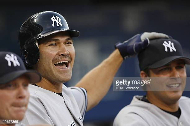 Johnny Damon of the New York Yankees has some fun prior to action against the Kansas City Royals at Kauffman Stadium in Kansas City Missouri on...