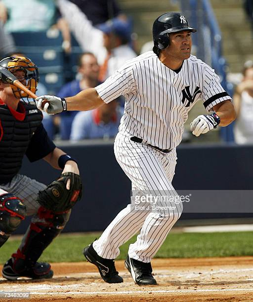 Johnny Damon of the New York Yankees hits a lead off home run against the Minnesota Twins in the first inning during a Spring Training game on March...