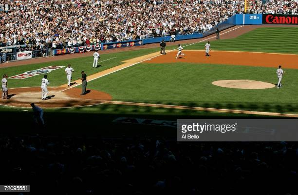 Johnny Damon of the New York Yankees rounds third base after hitting a threerun home run in the fourth inning of Game Two of the American League...