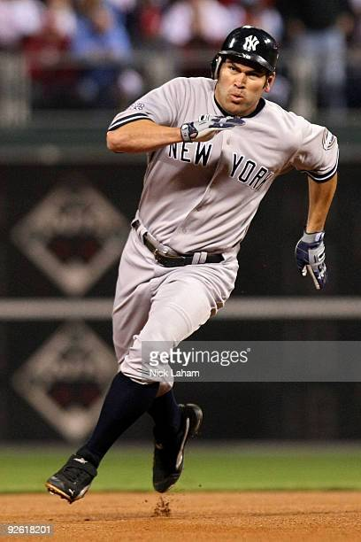 Johnny Damon of the New York Yankees runs towards third base as he scores on a RBI double by Alex Rodriguez in the top of the first inning against...