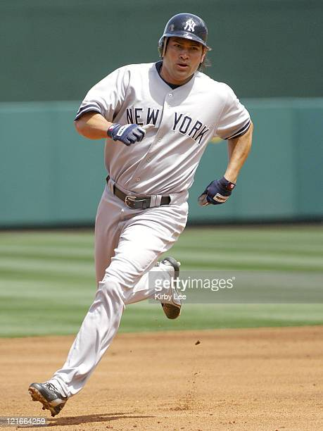 Johnny Damon of the New York Yankees sprints toward third base during 101 victory over the Los Angeles Angels of Anaheim at Angel Stadium in Anaheim...