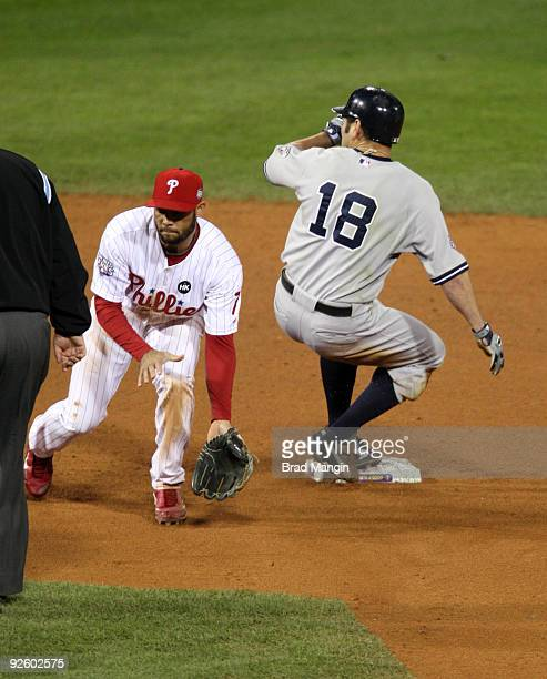 Johnny Damon of the New York Yankees steals second base in the top of the ninth inning of Game Four of the 2009 MLB World Series at Citizens Bank...