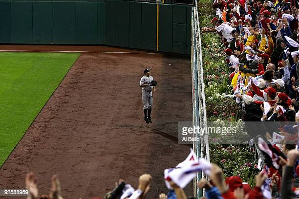 Johnny Damon of the New York Yankees watches as a Jayson Werth home run goes over the fence against the Philadelphia Phillies in Game Three of the...