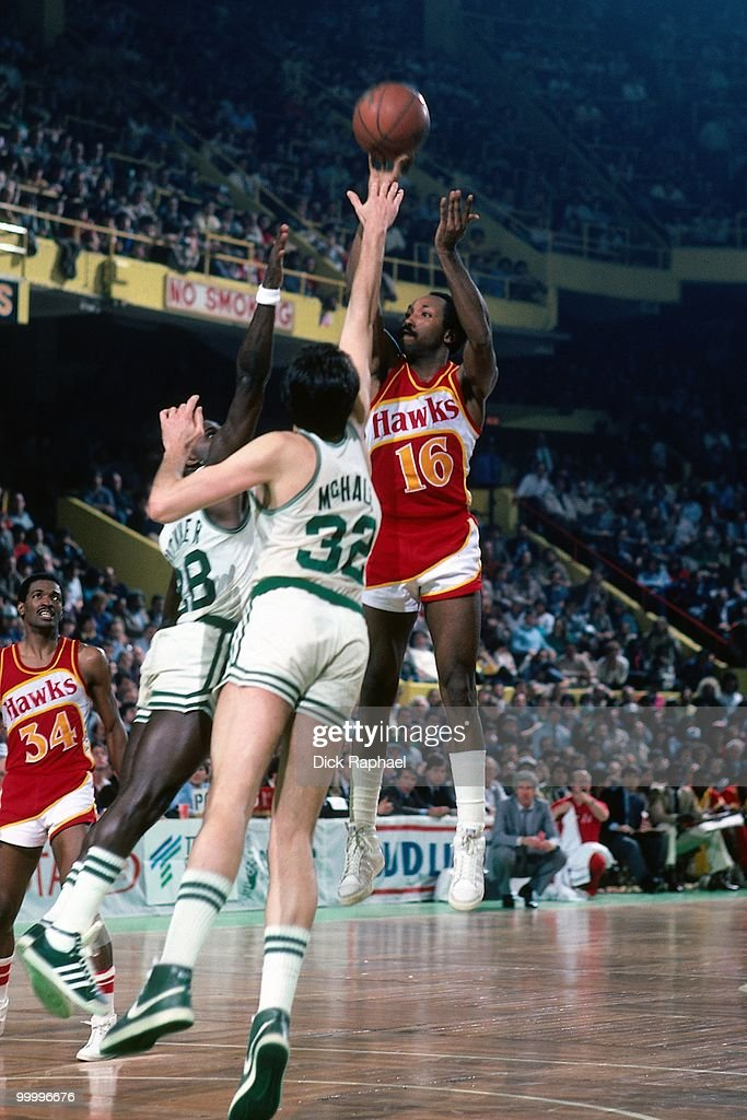 Johnny Davis #16 of the Atlanta Hawks shoots over Kevin McHale #32 of the Boston Celtics during a game played in 1983 at the Boston Garden in Boston, Massachusetts.