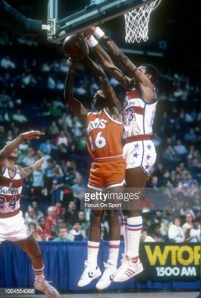 Johnny Davis of the Cleveland Cavaliers goes up looking to get his shot off over Charles Jones of the Washington Bullets during an NBA basketball...