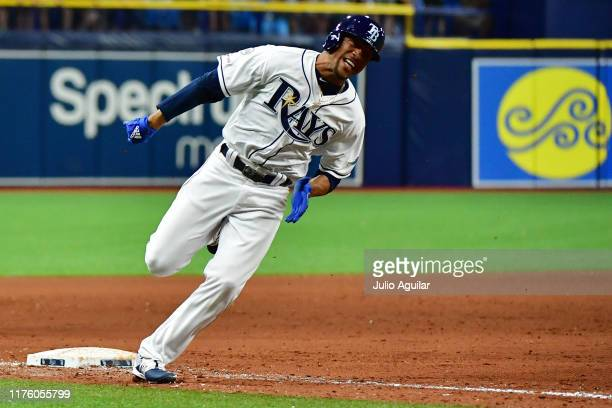 Johnny Davis of the Tampa Bay Rays rounds third after teammate Willy Adames hit an RBI single walkoff in the eleventh inning off of Trevor Kelley of...