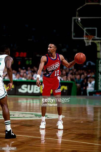 Johnny Dawkins of the Phialdelphia 76ers handles the ball against the Boston Celtics during a game played circa 1994 at the Boston Garden in Boston...