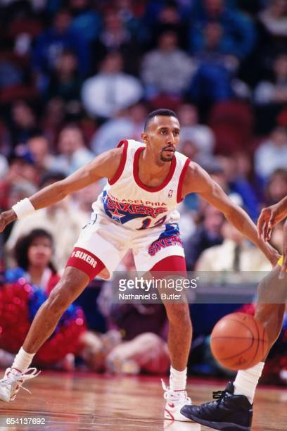 Johnny Dawkins of the Philadelphia 76ers defends against the Indiana Pacers during a game played circa 1993 at the Spectrum in Philadelphia...