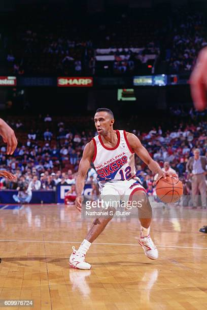 Johnny Dawkins of the Philadelphia 76ers dribbles during a game played circa 1993 at the Spectrum in Philadelphia Pennsylvania NOTE TO USER User...