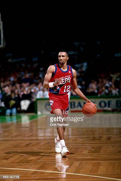 Johnny Dawkins of the Philadelphia 76ers dribbles during a game against the Boston Celtics played circa 1994 at the Boston Garden in Boston...