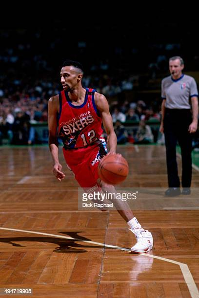 Johnny Dawkins of the Philadelphia 76ers drives against the Boston Celtics during a game played in 1992 at the Boston Garden in Boston Massachusetts...