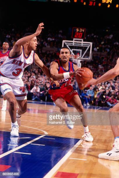 Johnny Dawkins of the Philadelphia 76ers drives against the New York Knicks during a game played circa 1993 at the Madison Square Garden in New York...