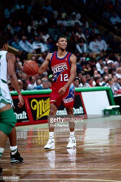 Johnny Dawkins of the Philadelphia 76ers handles the ball against the Boston Celtics during a game played in 1992 at the Boston Garden in Boston...