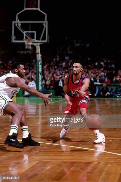 Johnny Dawkins of the Philadelphia 76ers makes a pass against the Boston Celtics during a game played in 1992 at the Boston Garden in Boston...