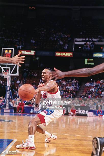 Johnny Dawkins of the Philadelphia 76ers passes the ball during a game played circa 1993 at the Spectrum in Philadelphia Pennsylvania NOTE TO USER...