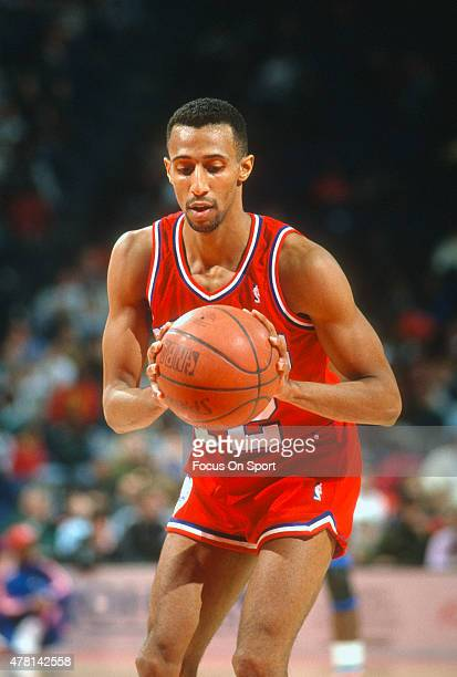 Johnny Dawkins of the Philadelphia 76ers set to shoot a free throw against the Washington Bullets during an NBA basketball game circa 1990 at the...