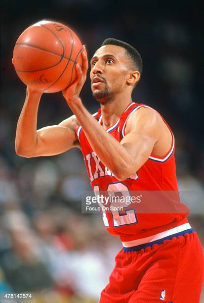 Johnny Dawkins of the Philadelphia 76ers shoots a free throw against the Washington Bullets during an NBA basketball game circa 1990 at the Capital...