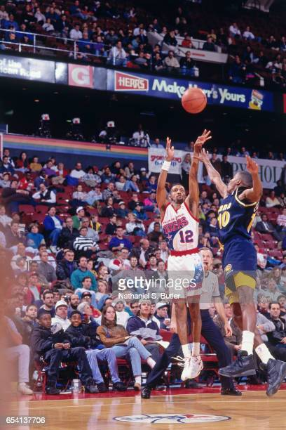 Johnny Dawkins of the Philadelphia 76ers shoots against the Indiana Pacers during a game played circa 1993 at the Spectrum in Philadelphia...