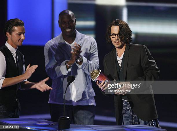 """Johnny Depp accepts Best Performance award for """"Pirates of the Caribbean Dead Man's Chest"""" from presenters Tyrese Gibson Shia LaBeouf and Josh..."""