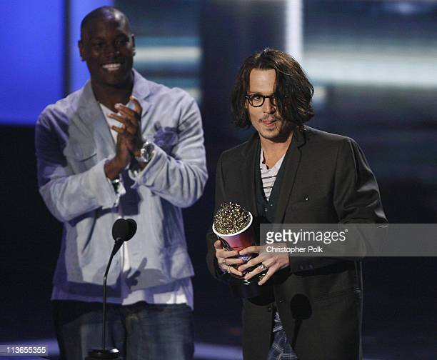 """Johnny Depp accepts Best Performance award for """"Pirates of the Caribbean Dead Man's Chest"""" from presenters Tyrese Gibson Shia LaBeouf and Josh Duhamel"""