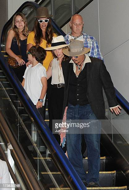 Johnny Depp, Amber Heard, Jack Depp and Lily Rose Melody Depp are seen upon departure at Narita International Airport on July 18, 2013 in Narita,...