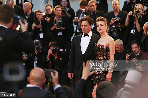 Johnny Depp and actress Amber Heard attend a premiere for 'The Danish Girl' during the 72nd Venice Film Festival at on September 5, 2015 in Venice,...