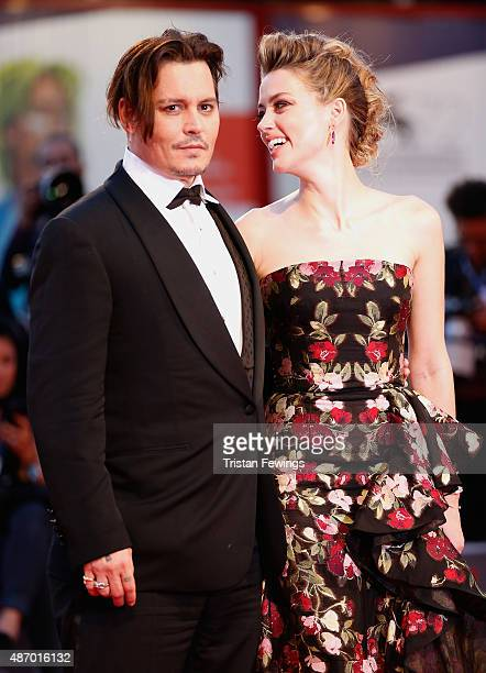 Johnny Depp and actress Amber Heard attend a premiere for 'The Danish Girl' during the 72nd Venice Film Festival at on September 5 2015 in Venice...