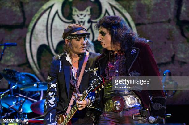 Johnny Depp and Alice Cooper of Hollywood Vampires perform live on stage at Wembley Arena on June 20 2018 in London England
