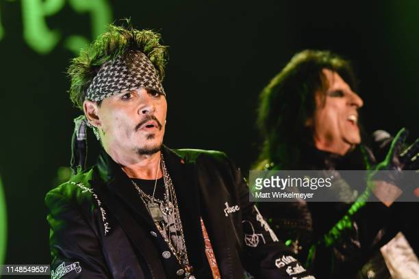 Johnny Depp and Alice Cooper of The Hollywood Vampires perform at The Greek Theatre on May 11 2019 in Los Angeles California