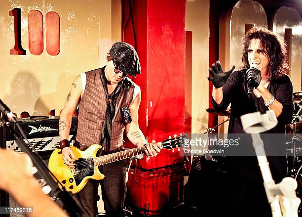 Johnny Depp and Alice Cooper perform together on stage at The 100 Club on June 26 2011 in London England