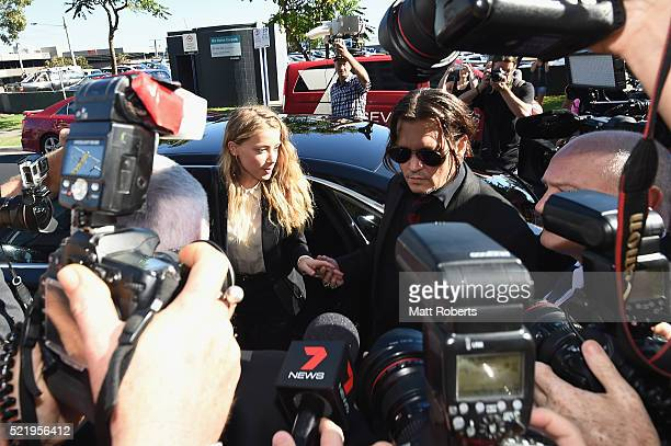 Johnny Depp and Amber Heard arrives at Southport Magistrates Court on April 18, 2016 in Gold Coast, Australia. Heard is facing two counts of...