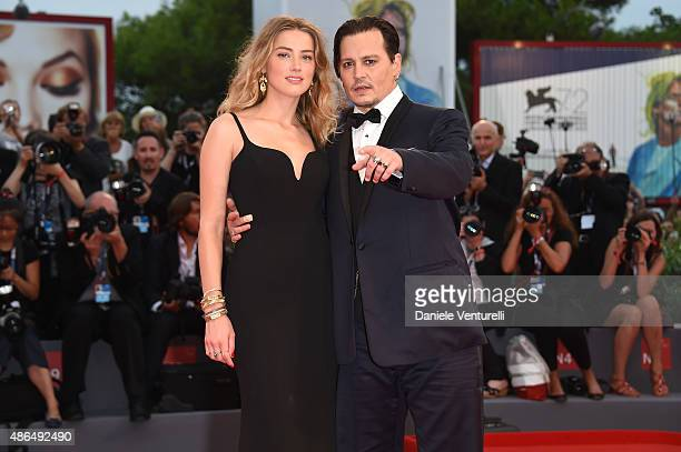 Johnny Depp and Amber Heard attend a premiere for 'Black Mass' during the 72nd Venice Film Festival at on September 4 2015 in Venice Italy