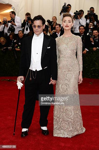 Johnny Depp and Amber Heard attend the Charles James Beyond Fashion Costume Institute Gala at the Metropolitan Museum of Art on May 5 2014 in New...