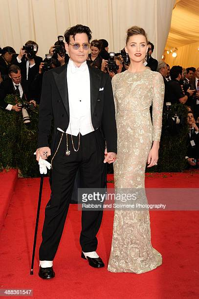 Johnny Depp and Amber Heard attend the 'Charles James Beyond Fashion' Costume Institute Gala>> at the Metropolitan Museum of Art on May 5 2014 in New...