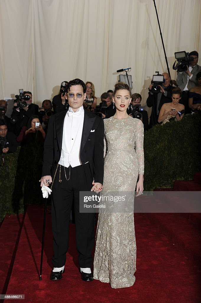 Johnny Depp and Amber Heard attend the 'Charles James: Beyond Fashion' Costume Institute Gala at the Metropolitan Museum of Art on May 5, 2014 in New York City.