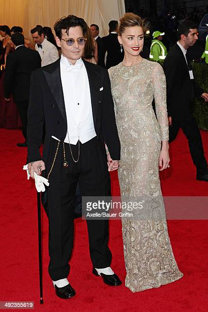 Johnny Depp and Amber Heard attend the 'Charles James Beyond Fashion' Costume Institute Gala at the Metropolitan Museum of Art on May 5 2014 in New...