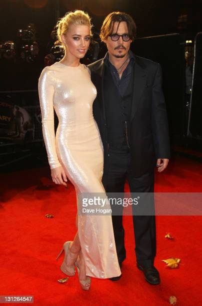 Johnny Depp and Amber Heard attend the European premiere of 'The Rum Diary' at The Odeon Kensington on November 3 2011 in London England