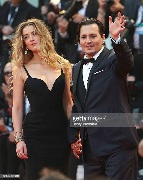 Johnny Depp and Amber Heard attend the premiere for 'Black Mass' during the 72nd Venice Film Festival on September 4 2015 in Venice Italy