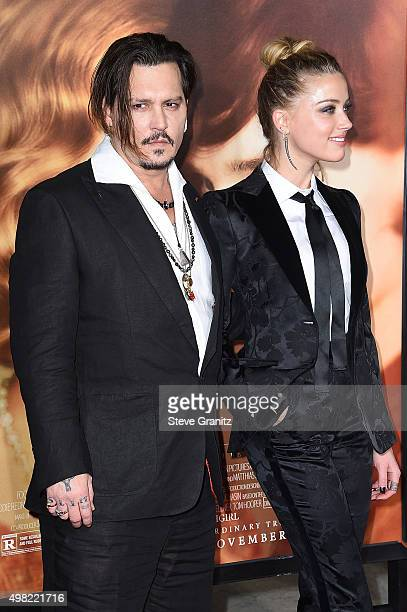 "Johnny Depp and Amber Heard attend the premiere of Focus Features' ""The Danish Girl"" at Westwood Village Theatre on November 21, 2015 in Westwood,..."