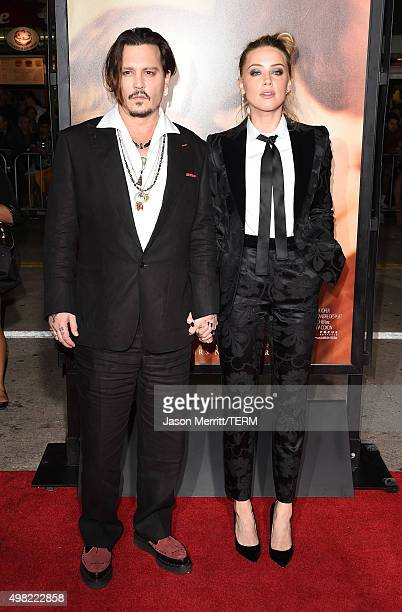 Johnny Depp and Amber Heard attend the premiere of Focus Features' The Danish Girl at Westwood Village Theatre on November 21 2015 in Westwood...