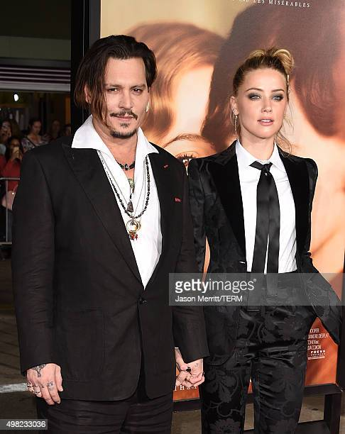 Johnny Depp and Amber Heard attend the premiere of Focus Features' 'The Danish Girl' at Westwood Village Theatre on November 21 2015 in Westwood...