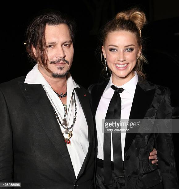 Johnny Depp and Amber Heard attend the premiere Of Focus Features' 'The Danish Girl' on November 21 2015 in Westwood California