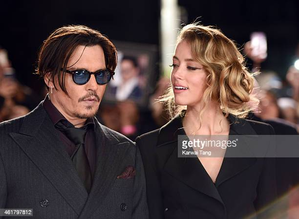 Johnny Depp and Amber Heard attend the UK Premiere of Mortdecai at Empire Leicester Square on January 19 2015 in London England