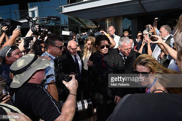 Johnny Depp and Amber Heard leave Southport Magistrates Court on April 18 2016 in Gold Coast Australia Heard is facing two counts of breaching...