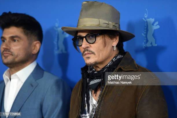 Johnny Depp and Andrew Levitas attend the Minamata photo call during the 70th Berlinale International Film Festival Berlin at Grand Hyatt Hotel on...