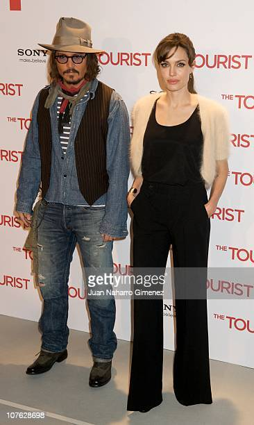 Johnny Depp and Angelina Jolie attend 'The Tourist' photocall at Villamagna Hotel on December 16, 2010 in Madrid, Spain.