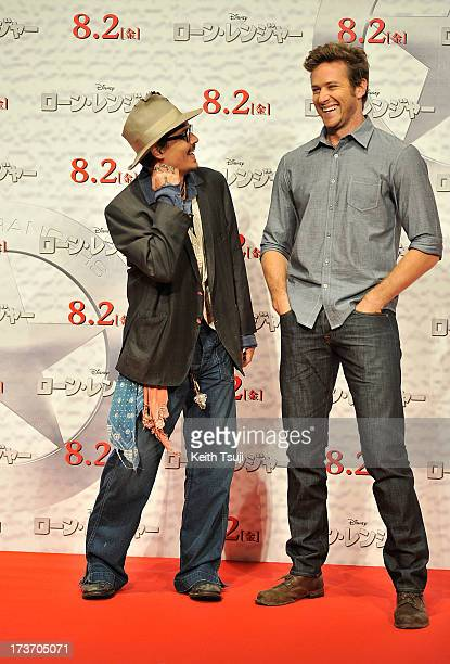 Johnny Depp and Armie Hammer attend the Lone Ranger photo call at Park Hyatt Tokyo on July 17 2013 in Tokyo Japan The film will open on August 2 in...